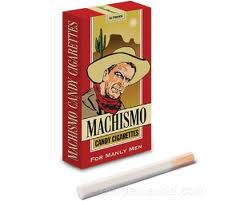 box of machismo brand candy cigarettes with a cowboy on the front and a cigarette sitting in front of it