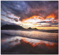 Every Cloud has a Golden Lining (Panorama Paul) Tags: sunset reflections capetown tablemountain nohdr sigmalenses nikfilters vertorama nikond300 wwwpaulbruinscoza paulbruinsphotography