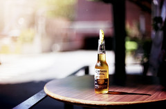 Some Sunshine (brandonhuang) Tags: light sun sunlight cold film beer sunshine analog table 50mm lemon nikon warm dof shine bokeh beverage sunny corona alcohol 400 fujifilm analogue nikkor f12 xtra supiera f801
