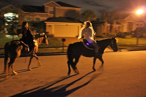 Trick-or-treaters on horseback
