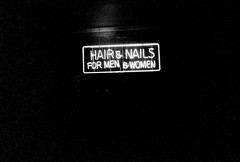Hair and nails for men and women (kevin dooley) Tags: street arizona urban bw white black men film sign shop night analog 35mm dark hair lens evening store lomo lomography women mainstreet closed main grain wide az business nails signage grainy extra mesa 22mm lasardina