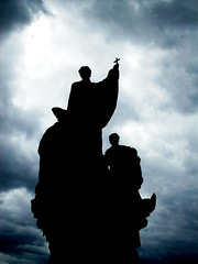 Redemption (eltuntricsi) Tags: bridge cloud church statue dark lights cross prague religion mysterious charlesbridge redemption