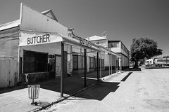 Butchered Town (Gav Owen) Tags: blackandwhite building tree monochrome architecture truck landscape blackwhite outdoor australia bin butcher newsouthwales outback derelict 32 canonef1740mmf4lusm wilcannia 2048 camera:make=canon exif:make=canon exif:isospeed=800 geo:country=australia canoneos5dmarkii geo:state=newsouthwales camera:model=canoneos5dmarkii gavowen exif:model=canoneos5dmarkii exif:lens=ef1740mmf4lusm exif:focallength=22mm exif:aperture=ƒ80 geo:city=wilcannia geo:lat=31559565 geo:location=60reidstwilcanniansw2836australia geo:lon=143377555