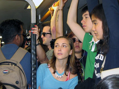 One-A-Day #112 (danieljsf) Tags: girl female youth standing stand women crowd bart young passengers teen teenager crowded bayarearapidtransit flickrchallengegroup thechallengegame