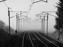 Into the Mist (Gilli8888) Tags: rail track fog linear railway railscape weather overheads wcml westcoastmainline blackandwhite mist railwaylines misty atsh spooky