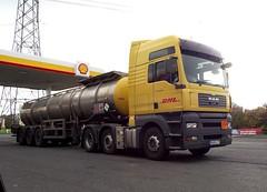 MAN D20 (steven.barker57) Tags: road uk england man station yellow truck tank diesel wheels transport lorry vehicle service trailer carpark freight articulated tanker dhl d20 billingham hartlepool a19 wolviston a689 october2011 ds33