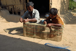 Father and son making fishing equipment, Bangladesh. Photo by WorldFish, 2007