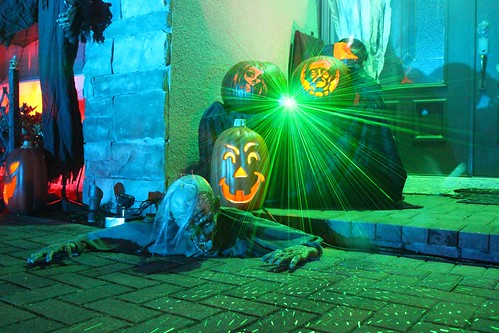 Remote-controlled zombie, pumpkins, and laser light