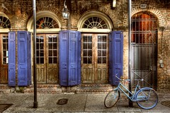 Bourbon Street Bike (Ken Yuel) Tags: unitedstates neworleans bricks bikes bicycles frenchquarter lousiana shutters woodendoors wroughtirondoors vintagedoors digitalagent kenyuel frenchquarterbars neworleansbars securedgates
