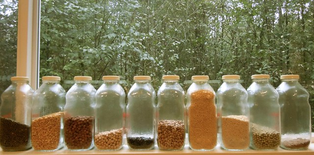 Beans and lentils in old school juice containers