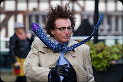 Caught in a gale (Alf's Work) Tags: christmas street wild portrait man hair manchester wind market tie windy blow performer blown wheather