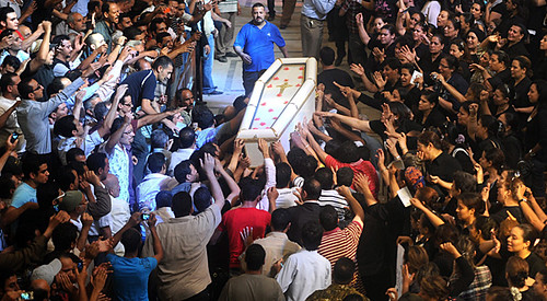 A funeral for Egyptian Christians killed by security forces in clashes. The tensions inside the country derived from the need for real democratic change. by Pan-African News Wire File Photos
