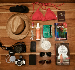 Getting ready (Vivi Caldern) Tags: summer brazil sun sol hat glasses packing playa books cameras verano planet gafas lonely sombrero vacaciones maleta pasaporte pasport brasilsol