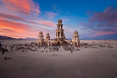 Burning Man Temple (IanBrewer) Tags: bikes blackrockcity burn burners burningman contentofphoto circle circletheater desert dramatic dusk dust festival holdinghands landscape nevada pinksky prayer structure sunset temporary usa bikers colorful costumes group intense magical paradise temple woodstructure temporarystructure art largesttemporaryartpiece peregrin flock spiritual