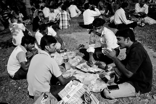 Many ate down on grass patches, eating their dinner and chatting before their bus ride home.