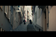 Uphill Battle (James Yeung) Tags: street switzerland couple candid zurich cinematic slope