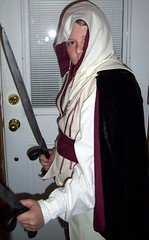 hayden as ezio with swords (groovyholly) Tags: halloween halloweencostume hayden assassin ezio recycledclothing homemadecostume assassinscreed yesimadeit halloween2011 handmadehalloweencostume eziocostume