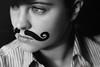 Movember (Lou Bert) Tags: portrait woman art girl face make up hat self paint makeup evil movember moustache curly genius bowler