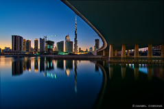 Tranquility (DanielKHC) Tags: bridge blue water skyline digital reflections bay still nikon long exposure dubai cityscape dusk uae business khalifa hour dri burj blending d300 danielcheong danielkhc tokina1116mmf28