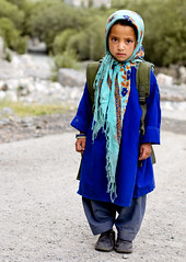 Turquoise Scarf. (Prabhu B Doss) Tags: school portrait india bus kids scarf nikon border remote himalayas ladakh highaltitude travelphotography jammuandkashmir 2011 baltistan bikeexpedition incredibleindia d80 transhimalaya turtuk prabhub prabhubdoss zerommphotography 0mmphotography