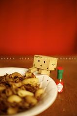 "Danbo loves ""koshari"" .. (Bayan AlSadiq) Tags: food hot sauce eating eat loves hotsauce koshary koshari danbo revoltech اكل كشري شطه danboard revoltechdanboard مجدره مجدرة"