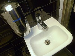 wash your hands please (helenoftheways) Tags: uk london freeassociation reflections stainlesssteel sink taps waterdrops toilets sterile washbasin ecolab blacktiles