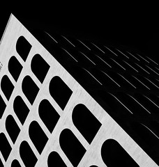 First Impressions (Gremxul) Tags: light shadow urban blackandwhite abstract monochrome lines silhouette architecture composition contrast shadows geometry curves shapes highcontrast shades minimal powershot negativespace shade abstraction minimalism eur abstractarchitecture g12 blackwhitephotos urbandetail palazzodellaciviltitaliana 1on1shadowsilhouettesphotooftheweek unusualviewsperspectives ministract gremxul canong12 canonpowershotg12 powershotg12