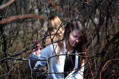 katieandabbyone (Digital CLR) Tags: red blur girl composition sticks woods forestry branches katie models fade accent fragments