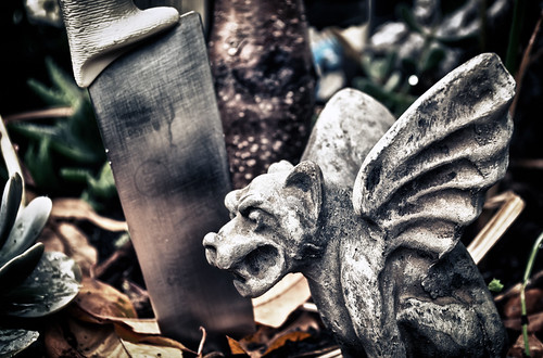 A Gargoyle, A Knife and a Tree Root by hbmike2000