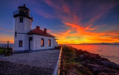 Alki Point Lighthouse Sunset (Fresnatic) Tags: seattle blue sunset red orange yellow lighthouses westseattle pacificnorthwest washingtonstate hdr elliotbay autumnsunset westcoastlighthouses alkipointlighthouse pacificcoastlighthouses lighthousetrek pacificnorthwestlighthouses canonrebelxsi lighthousesofwashingtonstate fresnatic pugetsoundlighthouses