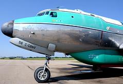Buffalo DC-4 Tanker 56 at Red Deer (John W Olafson) Tags: aircraft douglas waterbomber reddeer airtanker dc4 buffaloairways buffalojoe