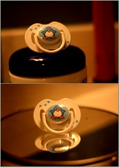 go back baby the way you came (255/365) (Mary Jo.) Tags: baby reflection collage canon bathroom rebel 50mm penguin warm mj picasa 365 manual xs f18 pacifier paci dyptych