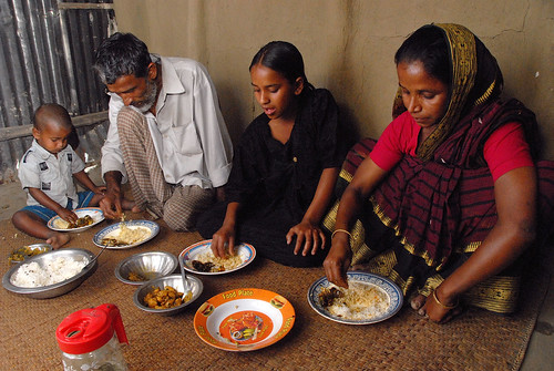 Eating fish and rice, Bangladesh. Photo by WorldFish, 2007