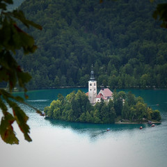 The church of St. Mary on the only natural island in Slovenia (Bn) Tags: travel blue girls summer two mountain lake holiday alps castle feet water swim geotagged island swan topf50 women hiking relaxing ducks tourist medieval romance slovenia alpine bled romantic picturesque stmary topf100 idyllic kasteel slopes barna glacial slovenian cerkev marijinega vnebovzetja blejski 100faves 50faves pletna slnblejskiotok churchofstmaryontheisland geo:lon=14090706 geo:lat=46362293
