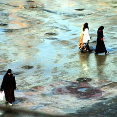 marrakech : after the rain has gone (gregjack!) Tags: street light people colour reflection lines square women hijab morocco marrakech djemaaelfna