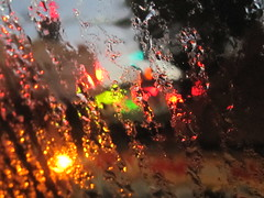 Rain and Abstract Traffic Lights (shaire productions) Tags: city light red abstract black trafficlights detail macro green water glass rain yellow night lights evening drops waterdrop colorful neon pattern traffic artistic bokeh drop droplet metropolis abstraction raining