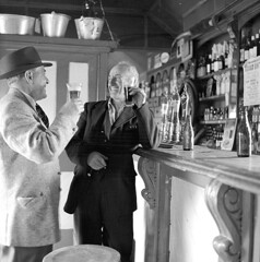 Cheers! James and Fred at Furey's Pub... (National Library of Ireland on The Commons) Tags: ireland bar wednesday pub photographer counter august taps alcohol 1960s 20thcentury 23rd sixties 1961 kildare publichouse leinster cie nationallibraryofireland fureys corasiompairireann moyvalley peopleidentified jamespodea odeacollection fredmcdonagh fureyspub
