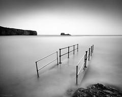Bridge To Troubled Water (Stewart Ayrey) Tags: longexposure bridge sea bw beach landscape coast cornwall atlantic perrenporth chapelrock nd110 lightroom3 silverefexpro2