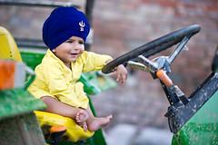 Chilling (gurbir singh brar) Tags: boy tractor chilling convention sikh littleboy johndeere khalsa 2011 nihang gurbirsinghbrar thevaliantones alamsingh nasmda tractorandboy