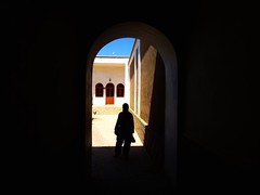 Incognito (peggyhr) Tags: blue windows friends sky woman brown sunlight white black grey doors shadows iran framed dcc curves cream textures backlit archway soe damghan wow1 wow2 digitalcameraclub couryard 25faves peggyhr flickrbronzeaward heartawards vanagrammofontheoldgramophone 100commentgroup flickraward visionaryartsgallery mygearandme lomejordemisamigos ringexcellence blinkagainforinterestingimages redgroupno1 yellowgroupno2 greengroupno3 p1130864ap