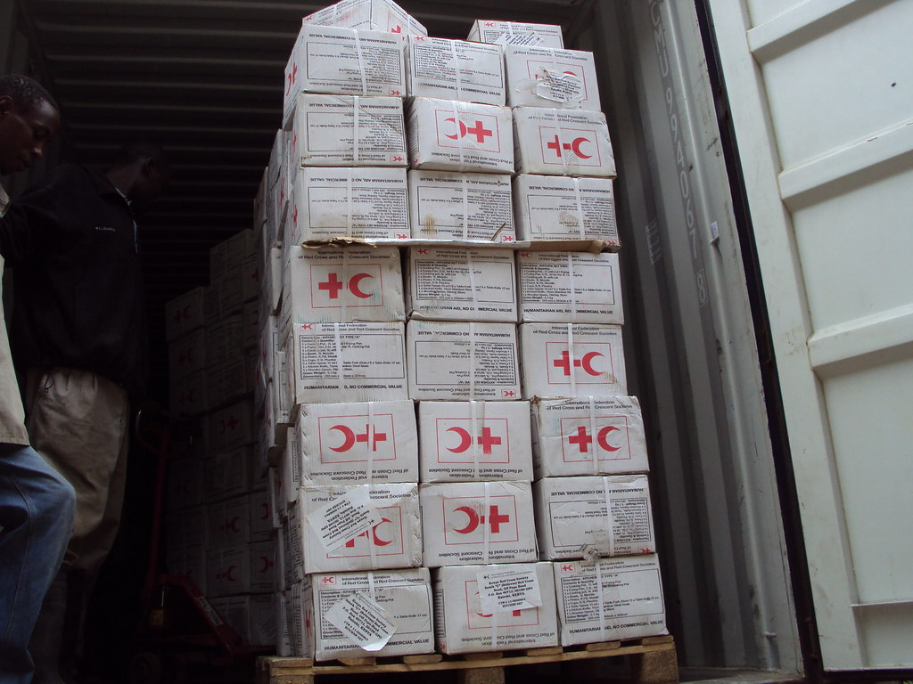 Unloading kitchen sets at Kenya Red Cross warehouse