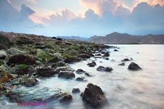 love the shiny rocks - Yitty -Oman (Beauty Eye) Tags: longexposure sunset sea seascape black beach clouds canon iso100 waterfall rocks filter f80 grad tamron oman snails muscat 30seconds 1024   blendedexposures 600d  yiti  seawaves yitti f110 f160  yitty