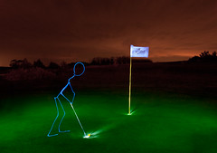 Un moment de golf (apophisnico) Tags: light people woman lightpainting man green club ball painting golf lampe nightshot lumire sony femme led tamron nuit homme bonhomme gaea balle a350 lancieux musictomyeyeslevel1 golflancieuxgaea