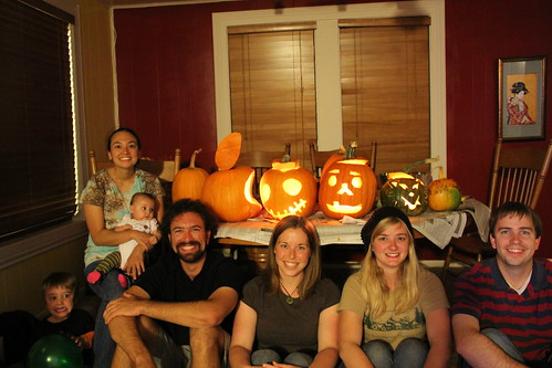 Pumpkins and their respective carvers