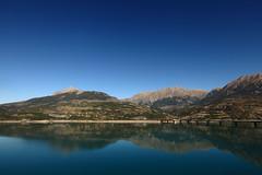 calm (crazyhorse_mk) Tags: sky mountain lake france nature water landscape mirror view calm reservoir calmness provencealpescotedazur lacserreponcon picoune