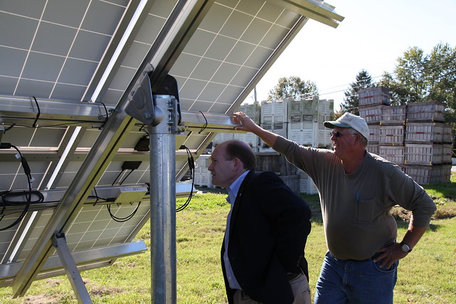 Senator Coons looking at solar panels on T.S. Smith & Sons farm.