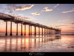 Sunset at Scripps (Chad McDonald) Tags: ocean california ca sunset sky orange sun west beach water clouds reflections concrete coast pier waves pacific sandiego chad lajolla pillars shores hdr mcdonald ucsd scripps scrippspier