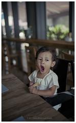 Hajar - Sleepy Mode (Kupih) Tags: dinner restaurant kid infant bokeh grain yawn rangefinder sleepy kodakmax400 manualfocus wideopen konicahexarrf hajar negativescanned hawwa kupih azwida hafizahmadmokhtar leicasummiluxm35mm14asph