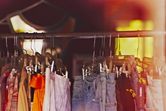 the politics of a mirror (earthquakefish) Tags: for clothing sale rack hanging merchandise