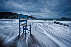 waiting for poseidon (helen sotiriadis) Tags: blue sky seascape beach water landscape temple chair published waves wind greece hour cape scape sounion sounio poseidons